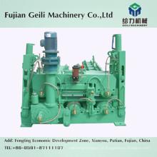 Máquina de retirada e endireitamento para processo de fundição