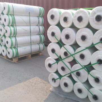 Polyethylene mesh wrapping bales of hay