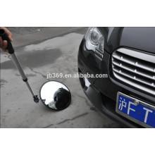 debajo del espejo de control de seguridad del vehículo