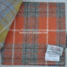 Verificação de laranja harris tweed tecido com etiqueta autorizada para o caso do telefone