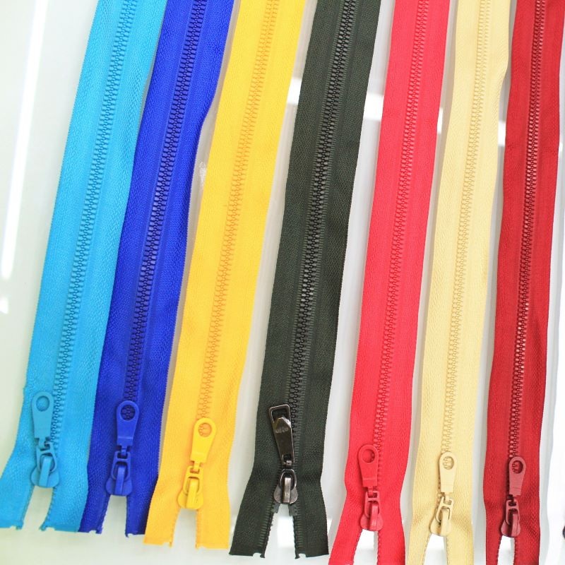 Continuous luggage zippers