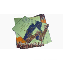 Laminated plastic bag for packing coffee beans