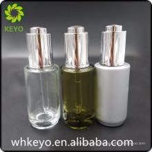 Garrafa de vidro do recipiente cosmético transparente luxuoso do óleo essencial 30ml com conta-gotas de imprensa