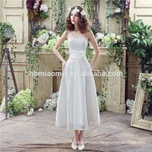 Spaghetti straps heavy beaded sexy short front long back wedding dress with small tail
