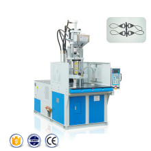 Machine rotatoire de moulage par injection de double station
