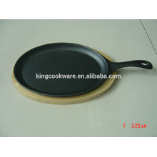 cast iron cookware sizzling pan wood tray