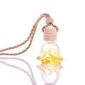 Botella del difusor del perfume del coche de la forma de la flor del diseño personalizado 6ml con una tapa de madera