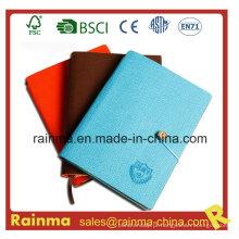 Caderno de papel com capa de couro e tecido