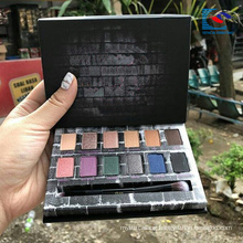 Black cardboard highlight cosmetics eyeshadow palette with eyeshadow brush