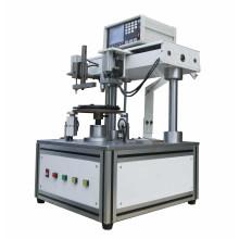 Machine à enrouler à bobines à induction à double couche