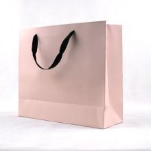 Elegante saco de compras de papel cartão rosa com alça