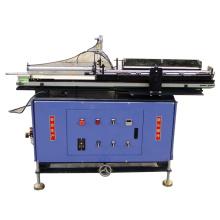 Chargeur de matériau pour machine à rouler les fils