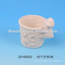 Ceramic flower pot with duck figurine