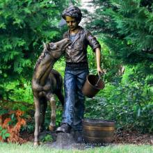 fonte de jardim de menino metal bronze ao ar livre com estátua de pônei