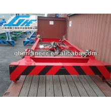 Semi-automatic container lift spreader for loading bulk material