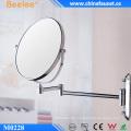 Espejo de baño doblado de maquillaje de latón con aumento 3X