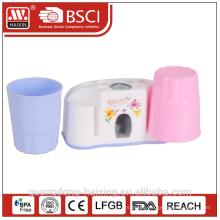 Plastic auto-toothpaste squeezer w/two cups