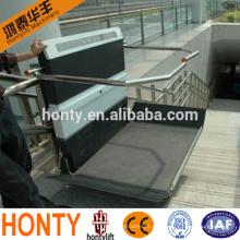 Silla de ruedas inclinada hidráulica para uso interior o exterior. Escalera para discapacitados.
