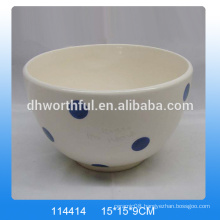 White hand painted ceramic bowls with blue dot painting