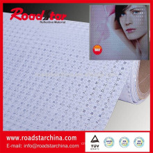 Fabric base microprismatic reflective sheeting for advertising