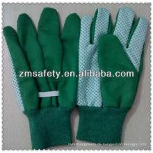 Grüne Baumwoll-Gartenhandschuhe mit PVC-Punkten auf palmJRG01