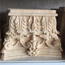Capitales de madera tallados a mano