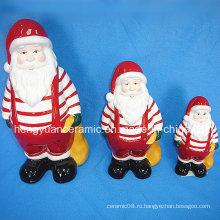 Керамический рождественский Санта-Клаус, переносящий подарочные пакеты