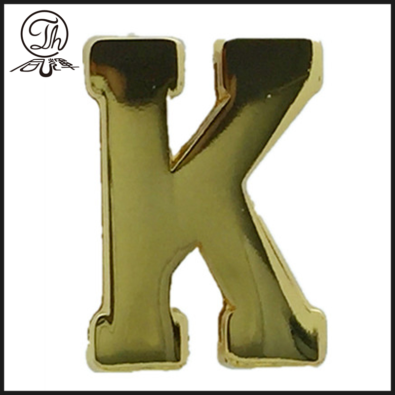 Gold K letter plate on the leather bag