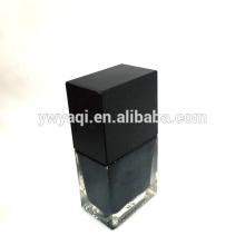 Square nail polish bottle with square black nail polish cap