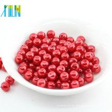 Pérola plástica redonda dos grânulos vermelhos redondos do furo da venda da fábrica para a arte do prego