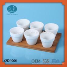 Fabricant en céramique de mini cafetières avec base en bambou, tasse à thé sans poignée