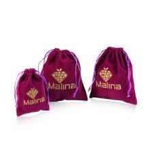 Drawstring Purple velvet bag with gold logo