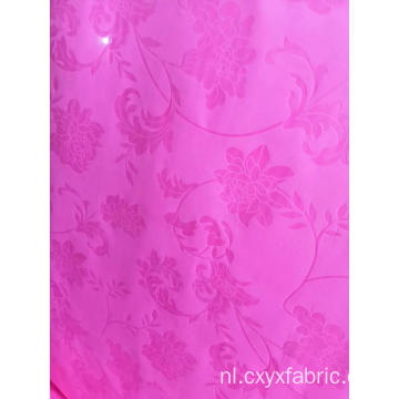 polyester roze paars emboss stof