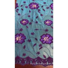 Tela para bordar malla con flores azules