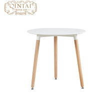MDF top and wooden legs round dining table