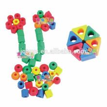 Hotsale niños plástico perlas threading juguetes