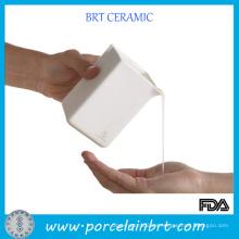 Masaje de recipiente de vela de cerámica blanca