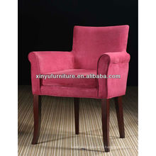 hotel guest room bedroom armchair with coffee table XY459