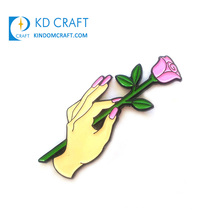 China manufacturers custom metal soft enamel elegant flower with hand shaped lapel pin for decoration