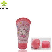 Cosmetics packaging label with flip top cap and packaging