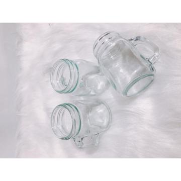 Glass storage bottle with handle