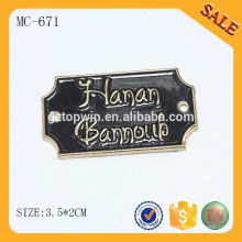 Le logo gaufré MC671 Eco-Friendly couvre des étiquettes personnalisées de jeans en métal