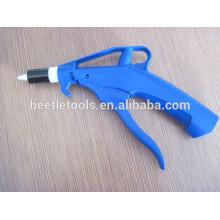 pistola de aire comprimido plástica azul jadeada con la boca