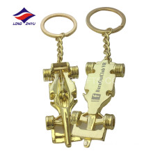 Casting cheap delicate car gold keychain with logo
