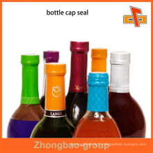 Heat sensitive customizable attractive tamper evident shrink bands for bottle neck packaging