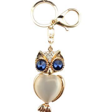 El llavero buho ojos azules con cristal interno