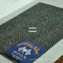 Durable and moisture resistant British herringbone tweed fabric