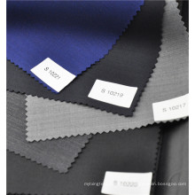 Venda quente azul lã penteada poliéster misturado tecido liso para uniforme de terno