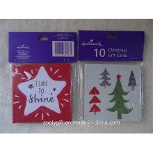 Mini cartões quadrados do presente do Natal ajustados e envolve