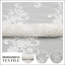 Custom oem Different kinds of beautiful tape voile embroidery fabric